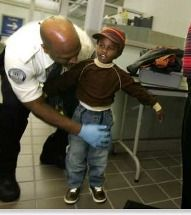 TSA official patting down a child