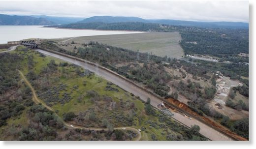 The damaged Oroville Dam spillway is shown.