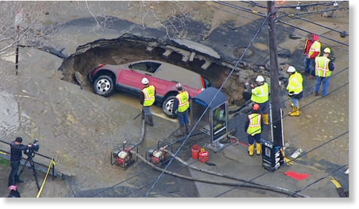 A huge sinkhole swallowed an SUV after a water main break flooded streets in Hoboken Tuesday morning.