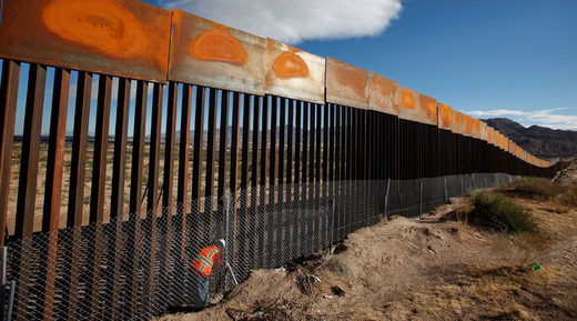 US worker inspects a section of the US-Mexico border wall
