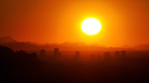 Temperatures in Phoenix have reached a new high, breaking a 70-year-old record. sun rise
