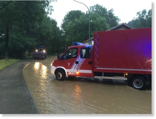 Local firefighters respond to flooding in Landshut, Bavaria, Germany, 12 June 2018.