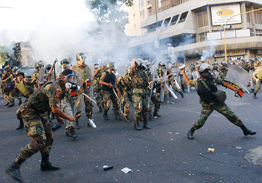 National Guards throw tear gas at President Hugo Chavez supporters