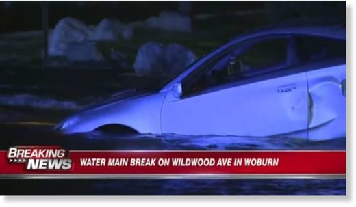 Sinkhole swallows car in Woburn