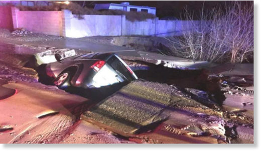 A sinkhole swallows an SUV