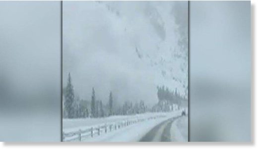 Avalanche barrels down mountainside towards highway in Colorado