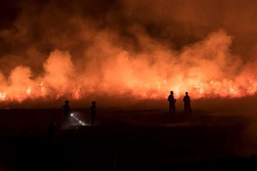 Firefighters tackle a blaze on moorland in northwest England