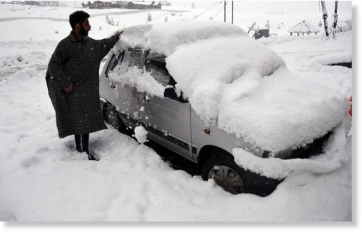 A man removing snow from a car during the first snowfall of the season in Gulmarg. While the snowfall has been moderate in the plains of Kashmir, the upper reaches have witnessed heavy snowfall.