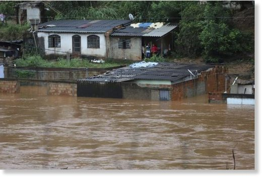 Houses hit by flooding in Minas Gerais state.