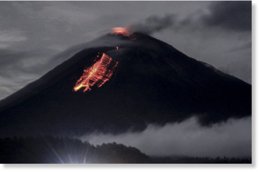 Lava flowing out of Mount Semeru's crater seen from Pranajiwo village near Lumajang in East Java on Wednesday.