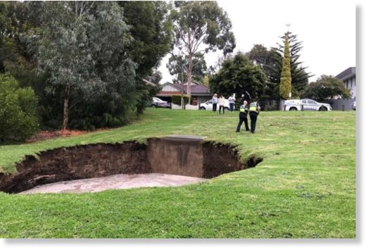 People at the scene were advised to keep 20 metres away from the hole as it continues to grow.