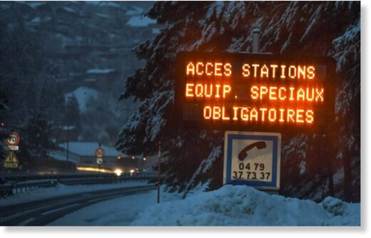 A sign on the road to Les Menuires and Val Thorens reads
