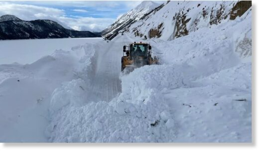A snowplow clears a path on the South Klondike Highway. On Tuesday, the highway was shut down.